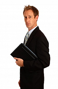 A young businessman isolated on a white background