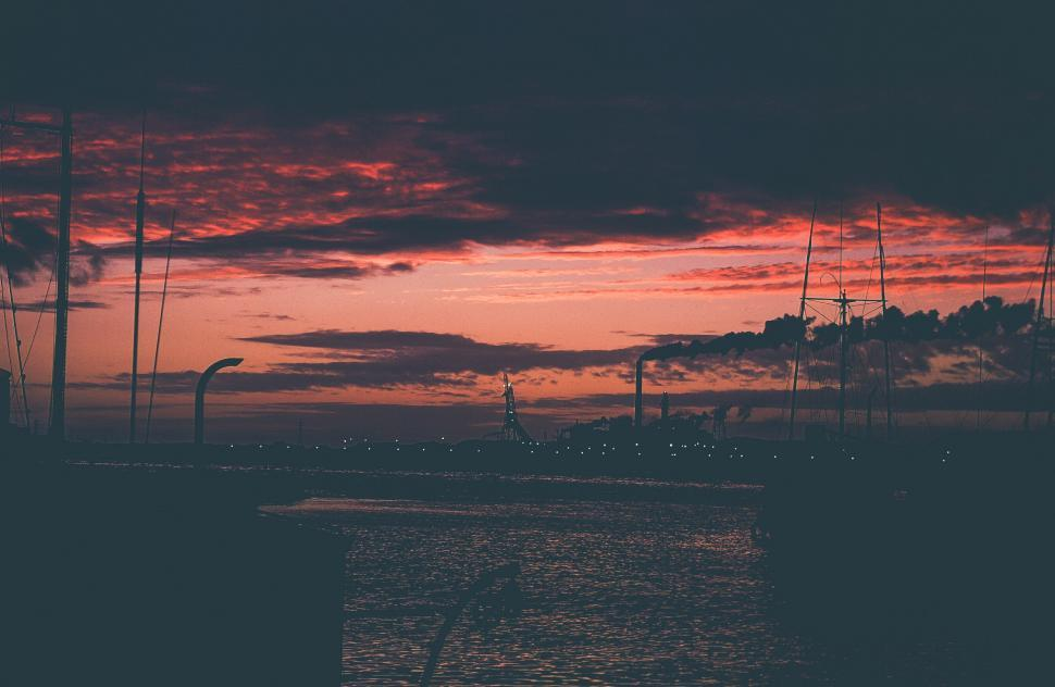 Download Free Stock HD Photo of Ocean and Industrial factory smoke from smokestacks Online