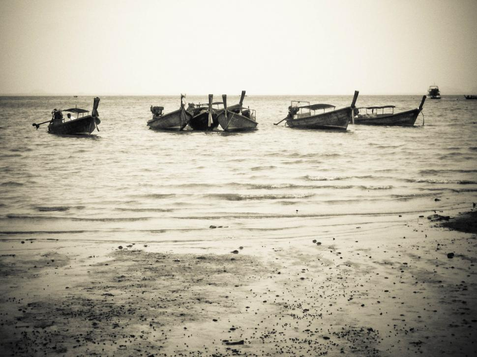 Download Free Stock HD Photo of row of boats on the beach Online