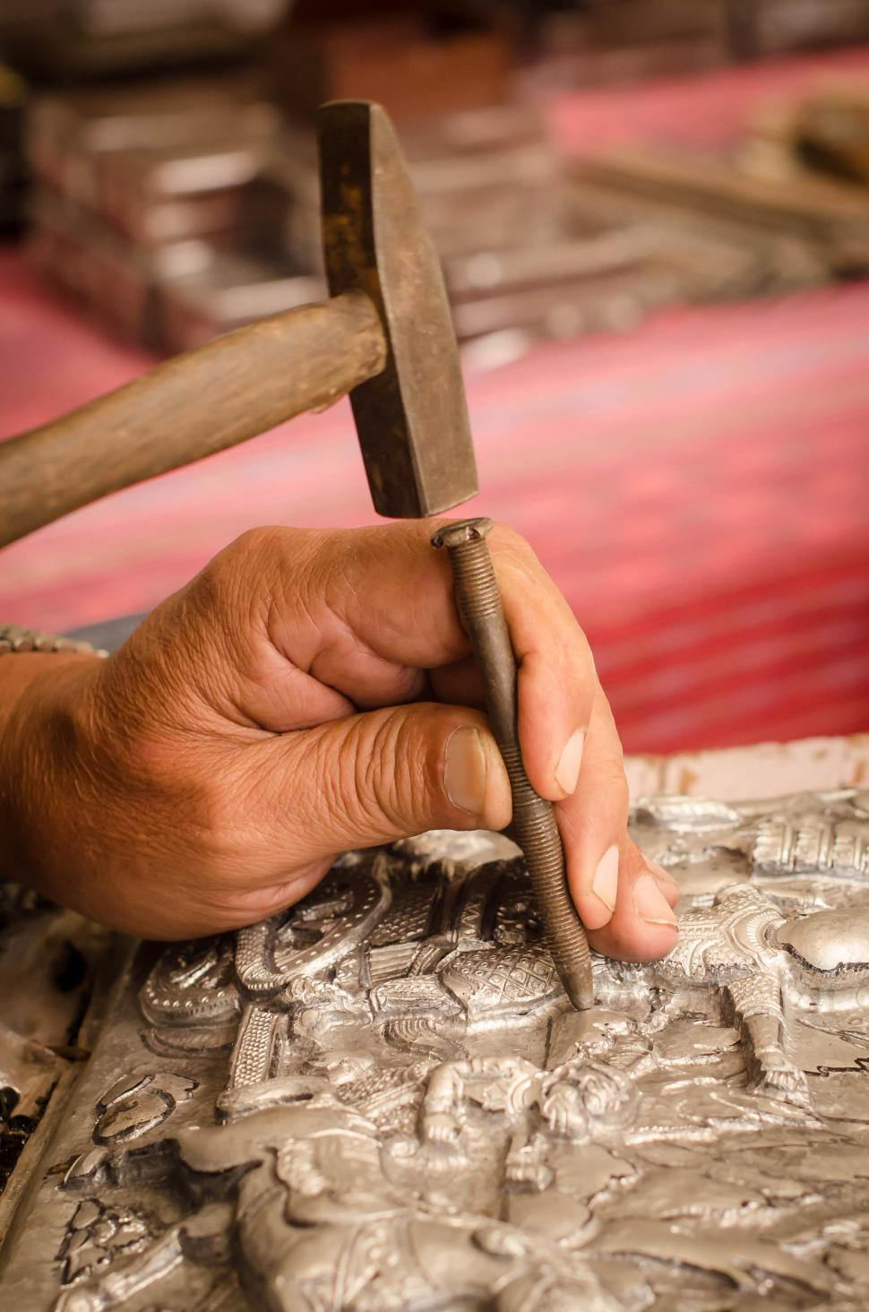 Download Free Stock HD Photo of Hand carving on silver  Online