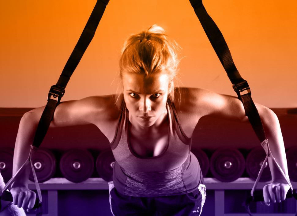 Download Free Stock HD Photo of Young Attractive Woman Training with HTRX Fitness Straps in the  Online