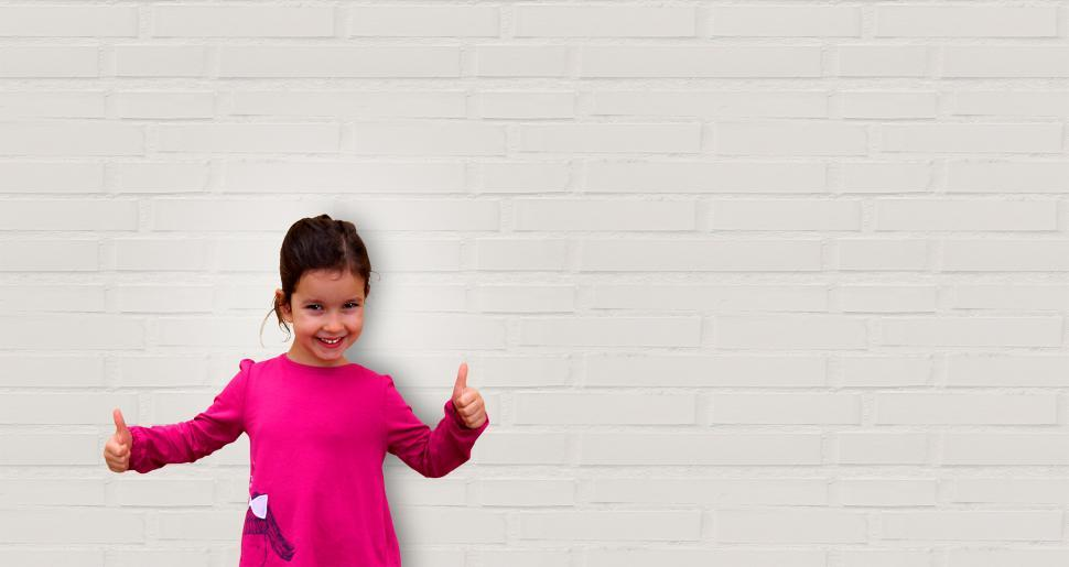 Download Free Stock HD Photo of Cute Little Girl Showing Thumbs Up - Background with Copyspace Online