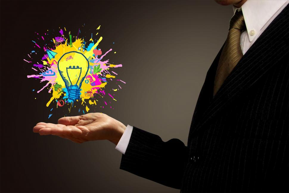 Download Free Stock HD Photo of Ideas at Hand - Businessman and Painted Lightbulb Online
