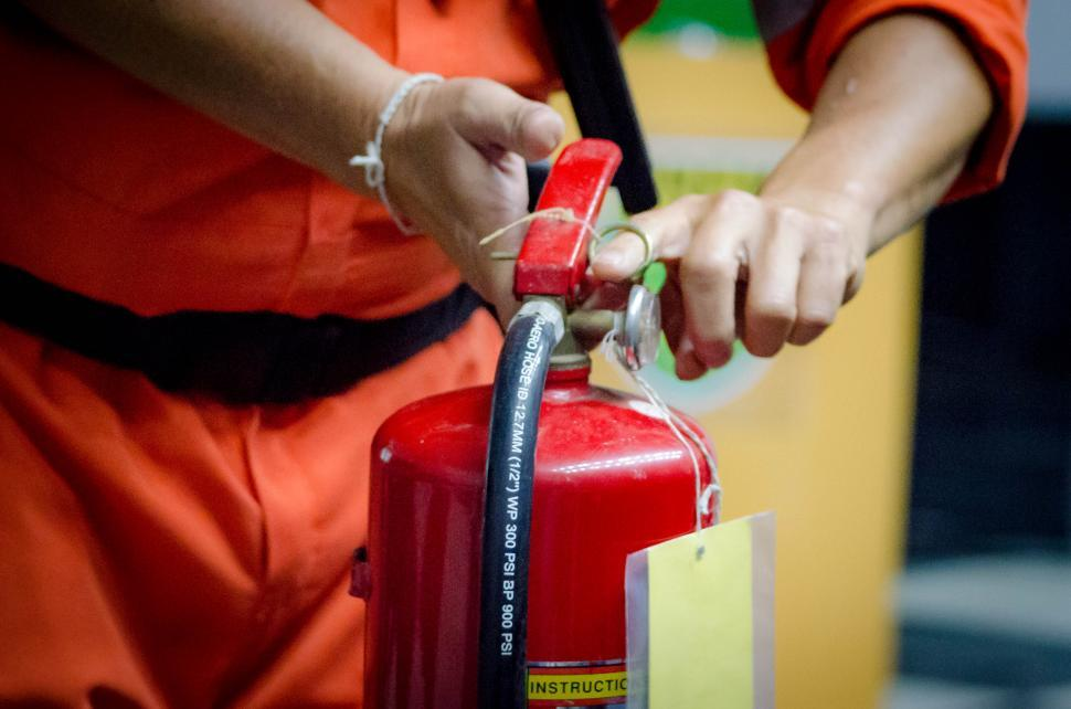Download Free Stock HD Photo of Pull the fire extinguisher pin Online