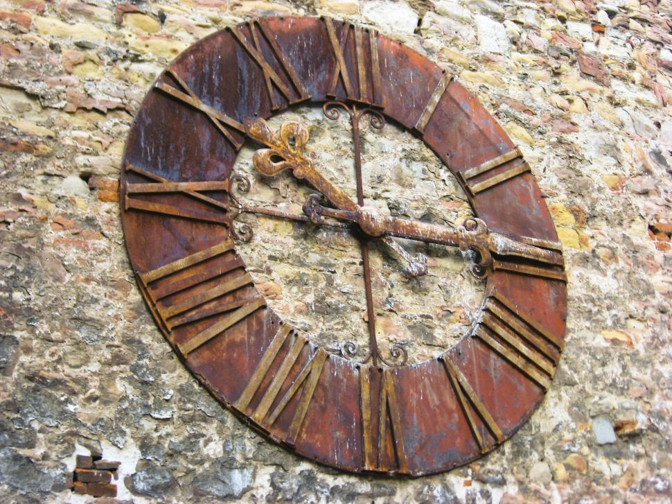 Download Free Stock HD Photo of Clock on stone wall Online