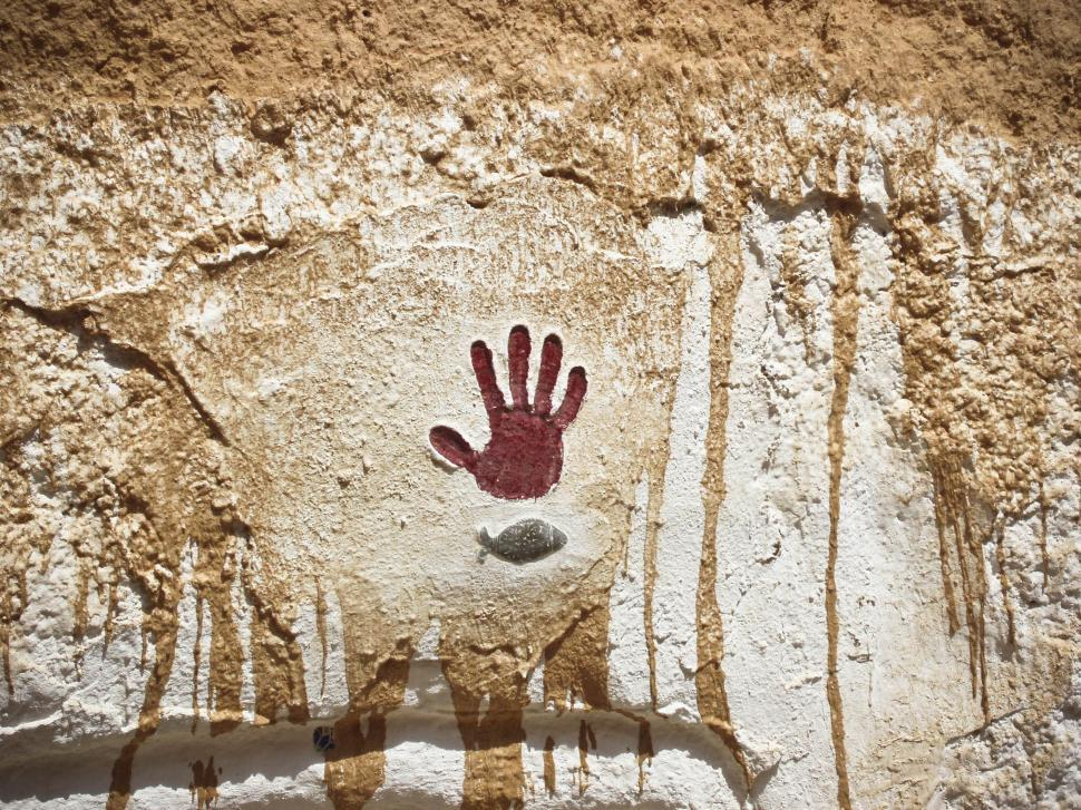 Download Free Stock HD Photo of hand print in stone Online