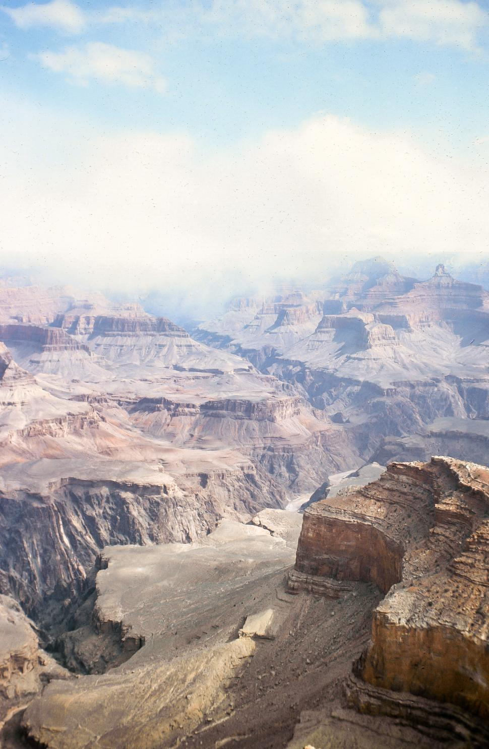 Download Free Stock HD Photo of Grand Canyon with low clouds Online