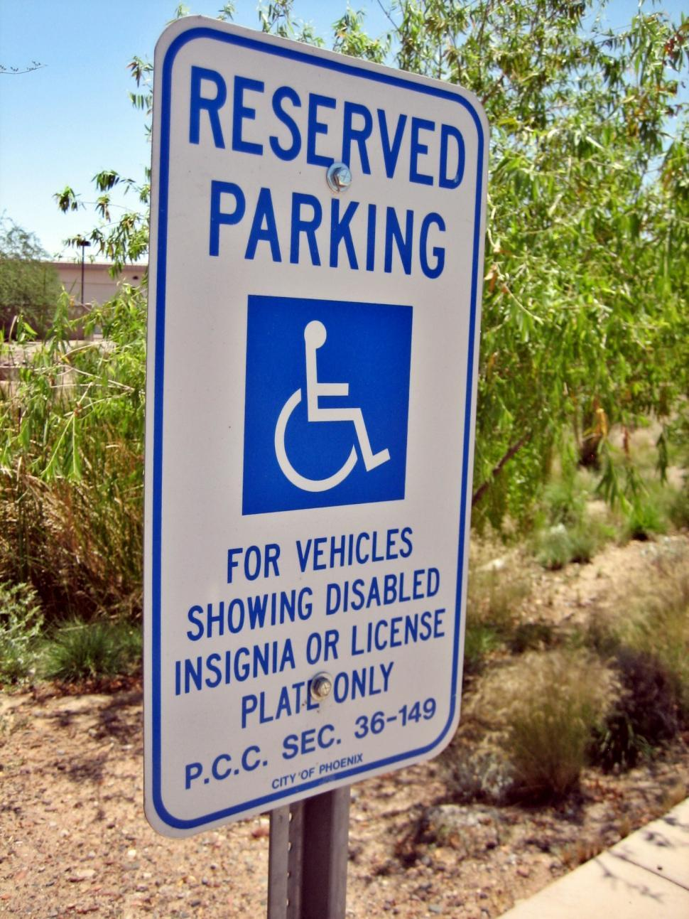 Download Free Stock HD Photo of Reserved Parking Sign for Disabled Online