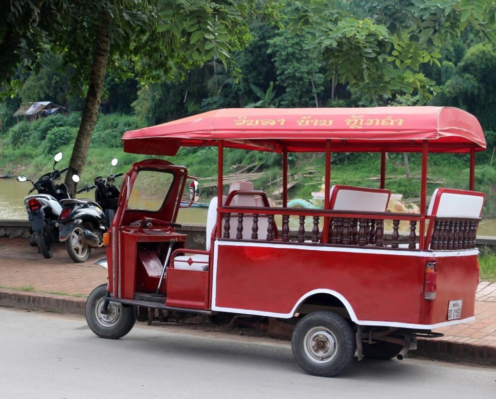 Download Free Stock HD Photo of Red Tuk Tuk parked  Online