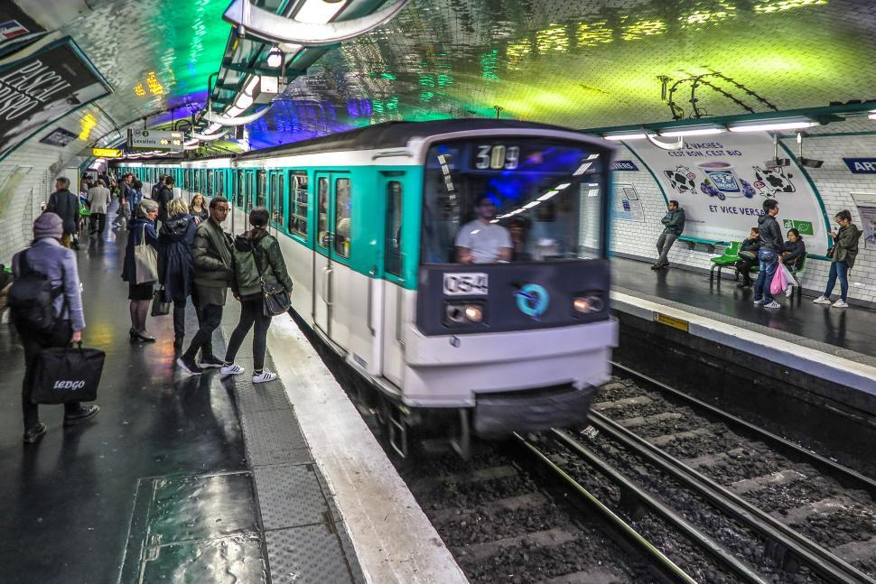 Download Free Stock HD Photo of Train entering Paris metro station Online