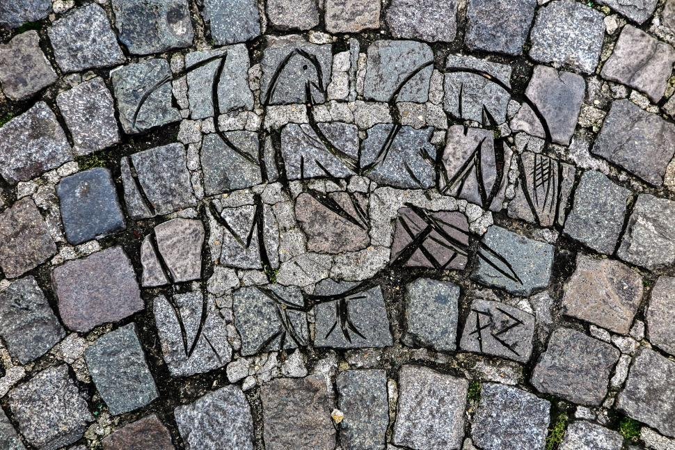 Download Free Stock HD Photo of Carving in cobblestones Online