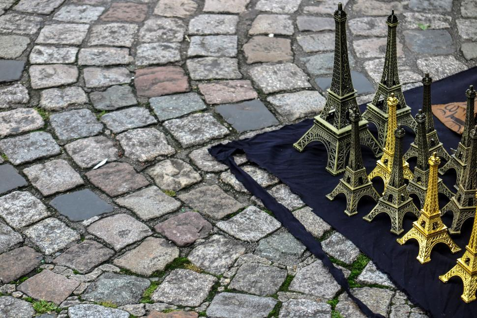 Download Free Stock HD Photo of Eiffel Tower Trinkets on a Blanket Online