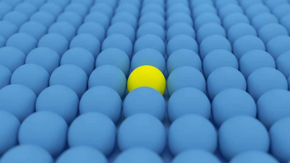 Free image of Field of blue spheres with one stand out in yellow.