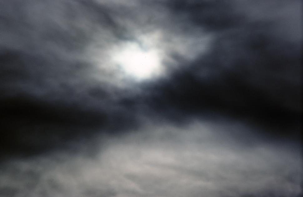 Free image of Moonlight passing through dark clouds