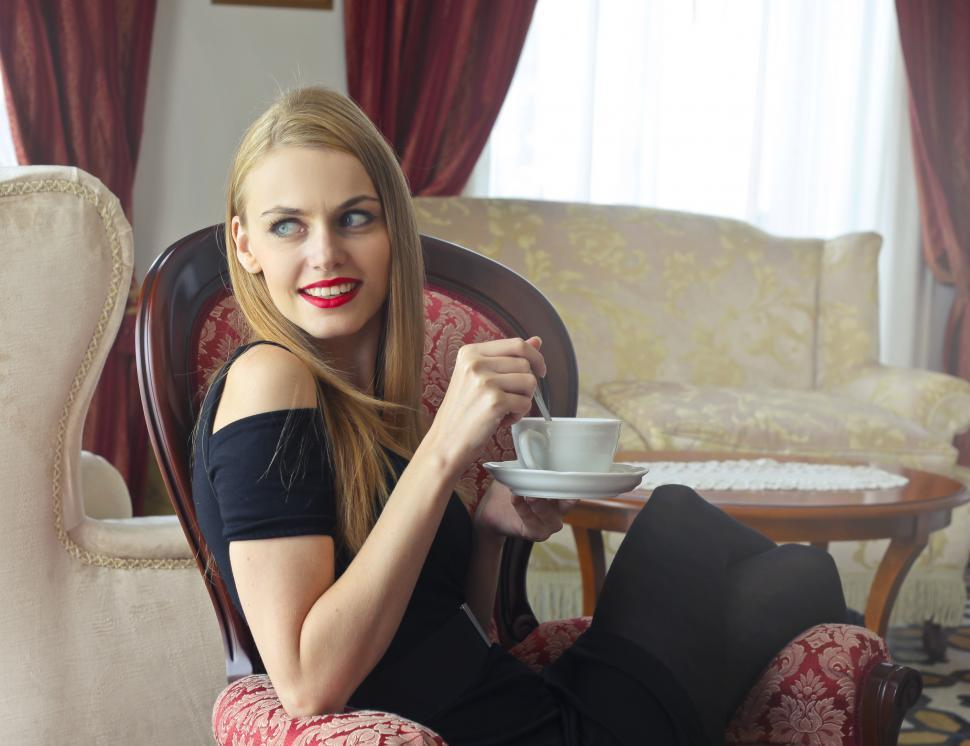 Download Free Stock HD Photo of Beautiful Young Blonde Woman In Red Lipstick Holding a saucer wh Online