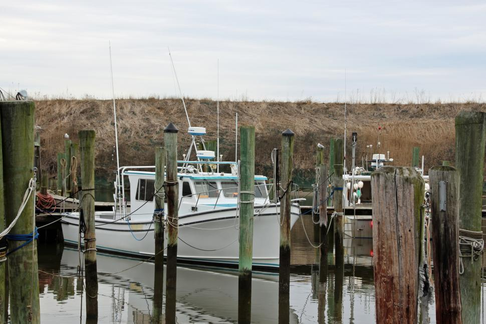 Download Free Stock HD Photo of Small Fishing Boats and Pilings Online