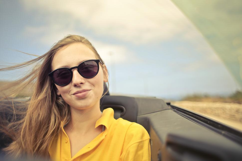 Download Free Stock HD Photo of Young Woman In Sunglasses And Yellow Shirt Online
