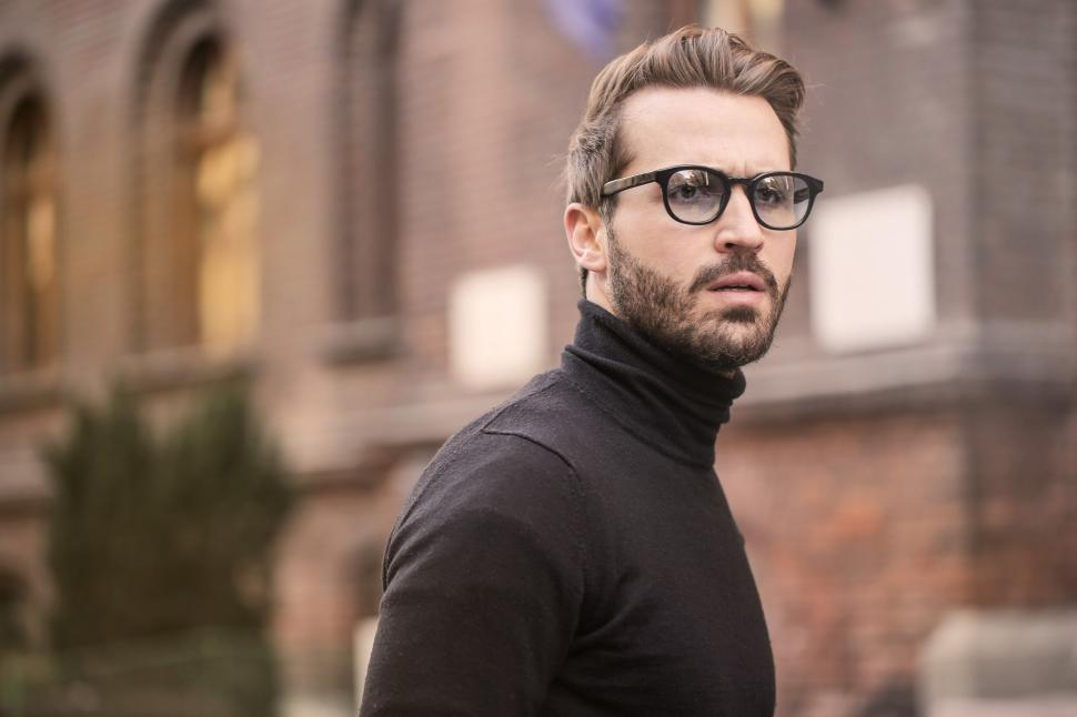 Download Free Stock HD Photo of Young Adult Man in black turtleneck top posing at the street Online