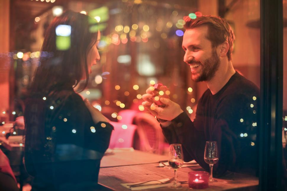 Download Free Stock HD Photo of Young Man proposing to his girlfriend in a bar Online