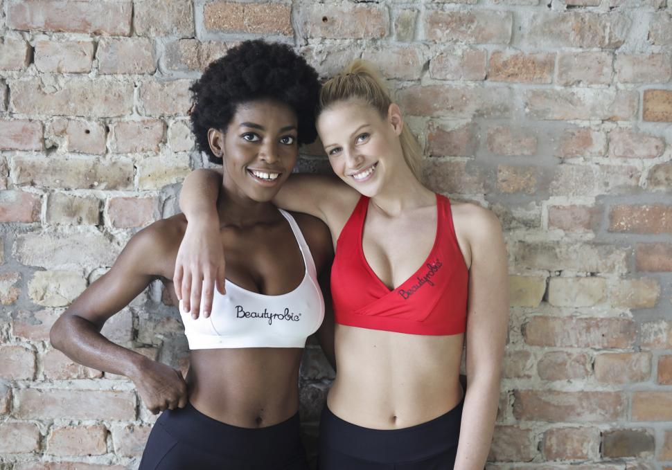 Download Free Stock HD Photo of Two Young Woman Posing Together In Aerobic Dance Class Online