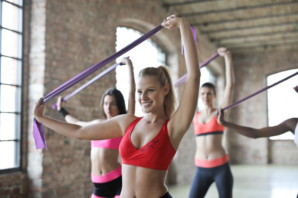 Download Free Stock HD Photo of Three Young Women Doing Exercises Online