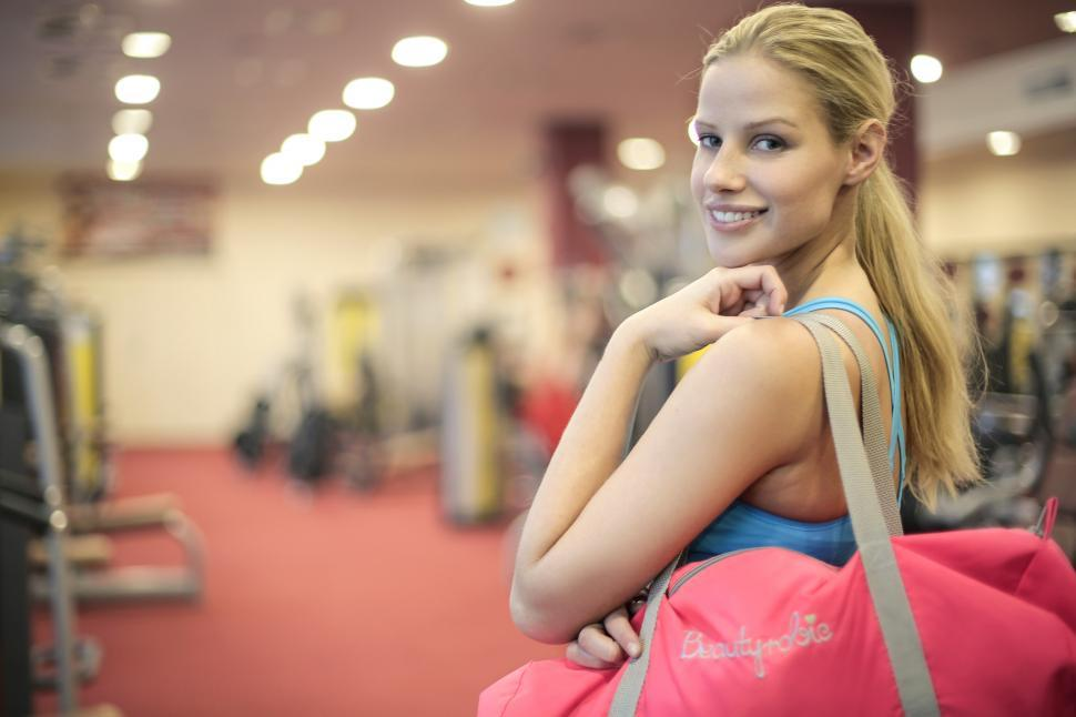 Download Free Stock HD Photo of Young Woman Leaving a gym after working out Online