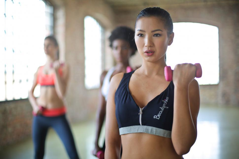 Download Free Stock HD Photo of Group Of Women Doing Dumbbell Exercises Online