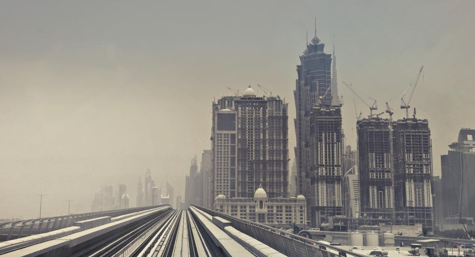 Download Free Stock HD Photo of View of the Metro Line and Skyscrapers in Dubai Online