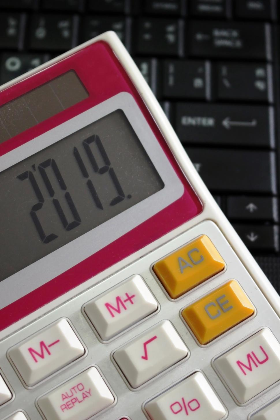 Download Free Stock HD Photo of 2019 on a Calculator Screen on a Computer Keyboard  Online