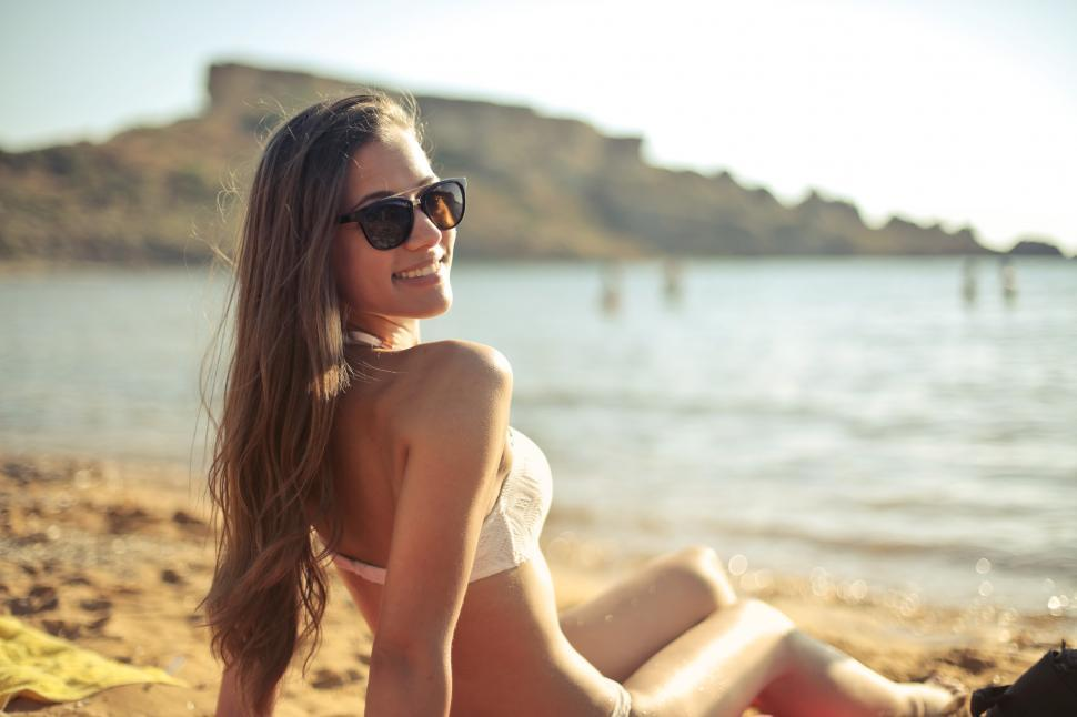 Download Free Stock HD Photo of Young Woman Relaxing At Beach Online