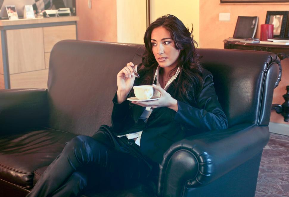Download Free Stock HD Photo of Woman in Black Blazer Holding Teacup and spoon Online