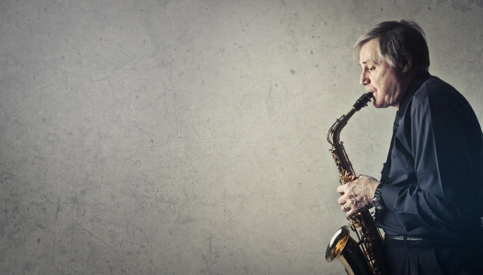 Download Free Stock HD Photo of Middle Aged Man Playing Saxophone Online