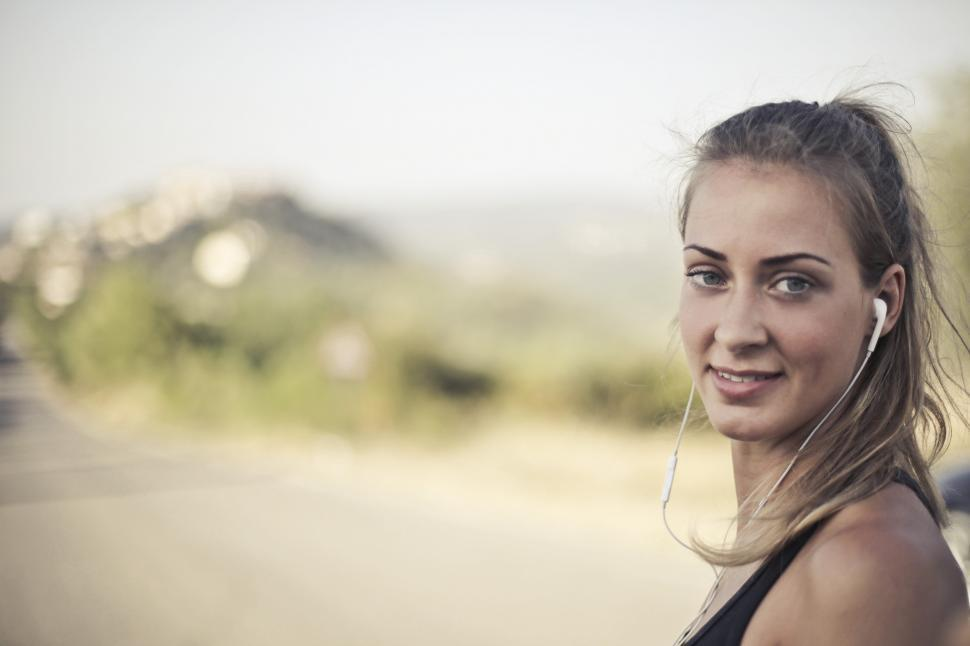 Download Free Stock HD Photo of Woman In Black Tank Top And White Earbuds Online