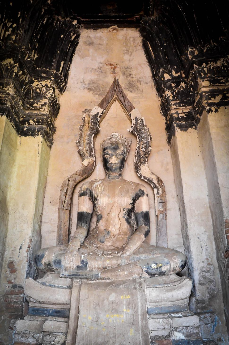 Download Free Stock HD Photo of Buddha Statue in Crumbling Ruins Online