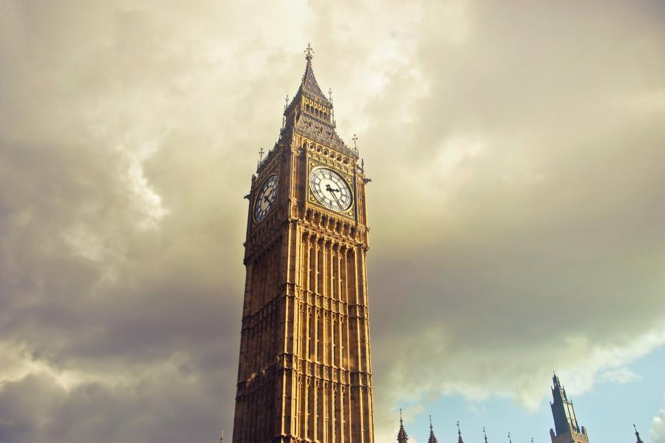 Download Free Stock HD Photo of Low Angle View Of Big Ben With Cloudy Sky in London, England Online