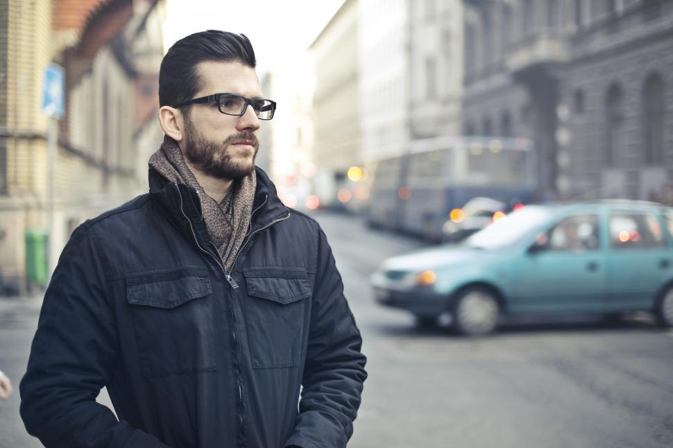 Download Free Stock HD Photo of Young Bearded Man Standing On The Street Online