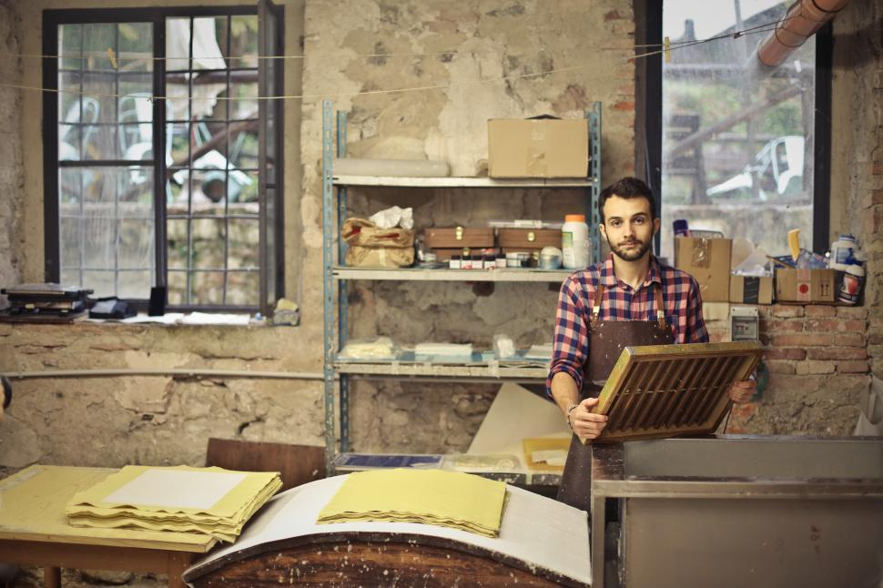 Download Free Stock HD Photo of Young Bearded Man Working In Paper Mill Online