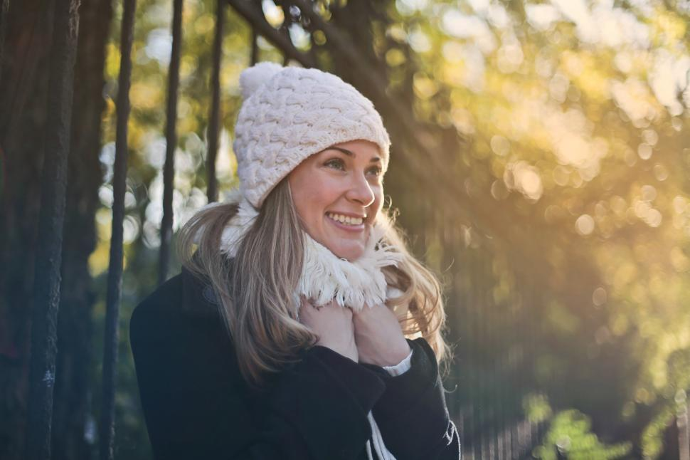 Download Free Stock HD Photo of Young Woman in scarf and skull cap Online