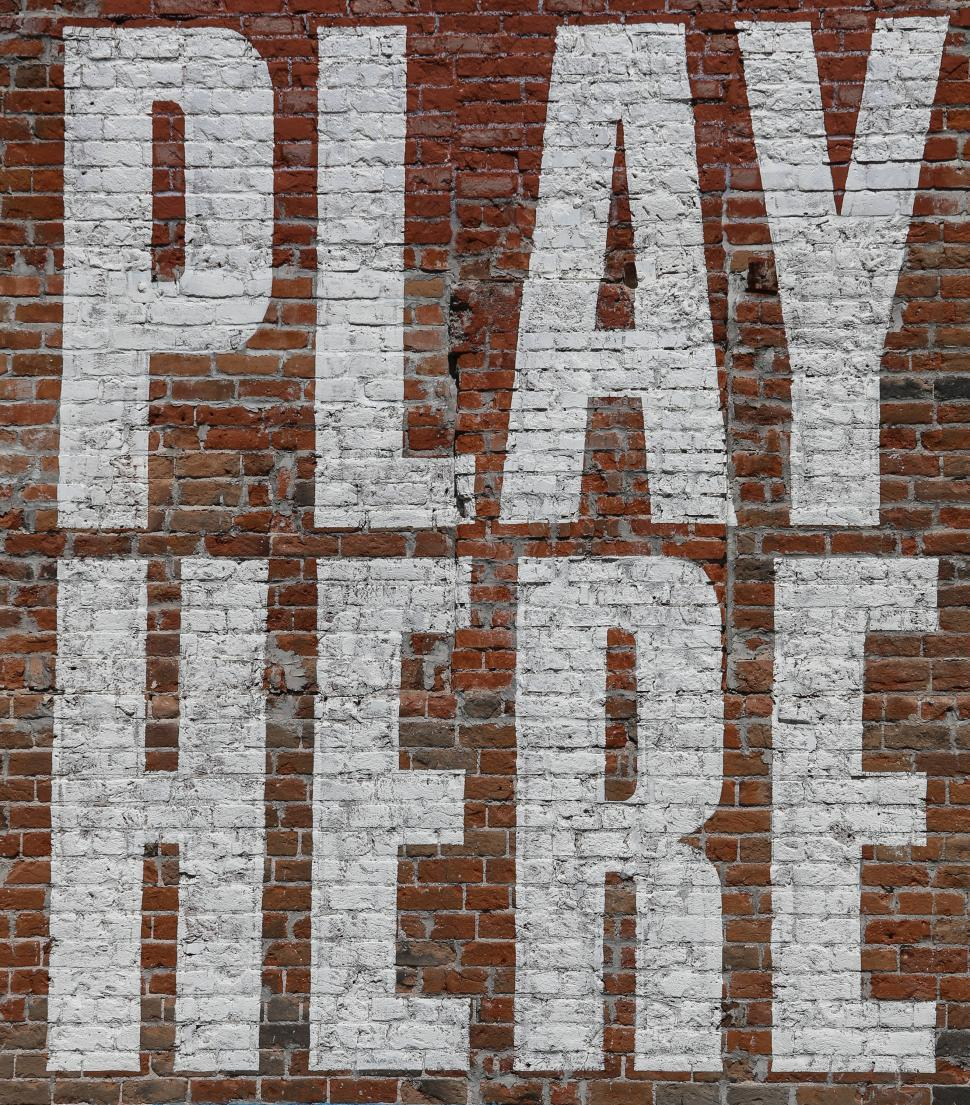 Download Free Stock HD Photo of Massive Play Here sign Online