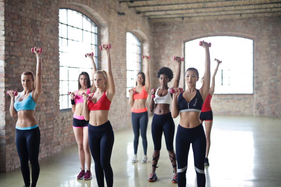 Download Free Stock HD Photo of Group of young multiethnic women doing weight training in the gy Online