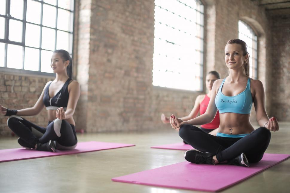 74655f9ee07 Download Free Stock HD Photo of Three young women sitting in yoga posture  on the floor