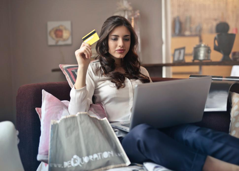 Download Free Stock HD Photo of Young Adult woman using her credit card to shop online Online