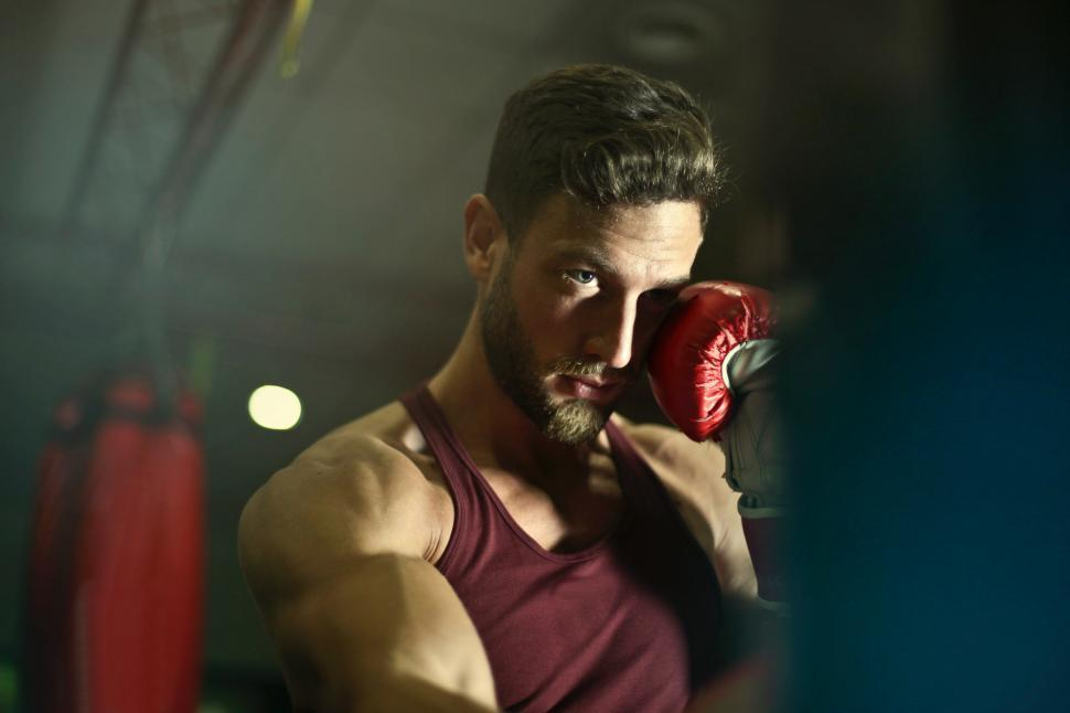 Download Free Stock HD Photo of A young caucasian man man wearing boxing gloves Online