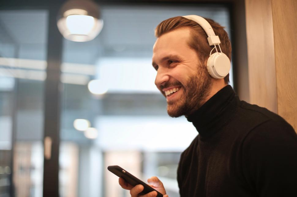 Download Free Stock HD Photo of A young caucasian man listening to music on headphones Online