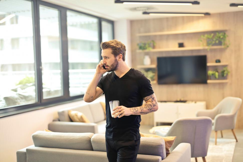 Download Free Stock HD Photo of Man on the phone in the living room Online