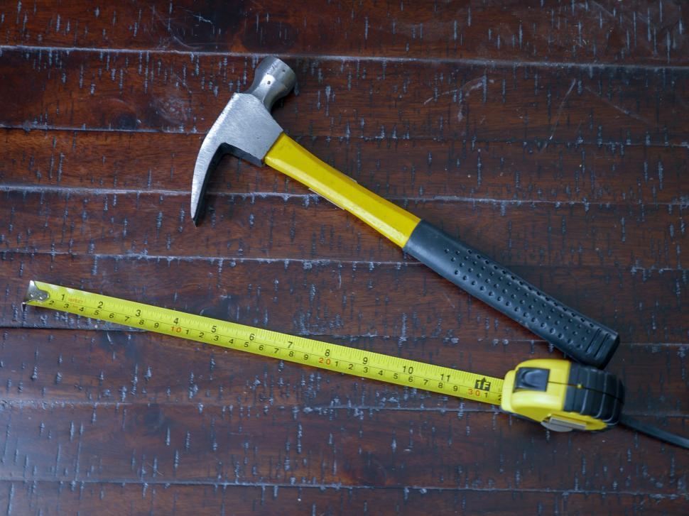Download Free Stock HD Photo of Hammer and measuring tape - Top View Online