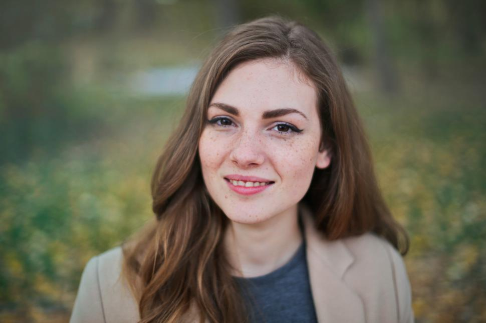Download Free Stock HD Photo of Portrait Of Brown Haired Young Woman In Brown Jacket Online