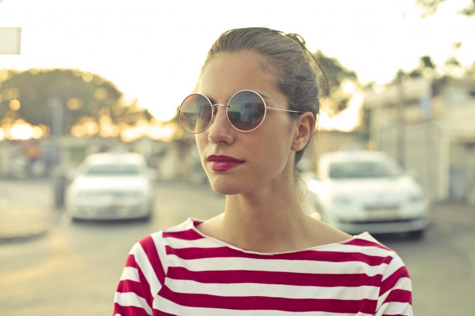 Download Free Stock HD Photo of Young Woman In Sunglasses And Red And White Striped T-Shirt Online