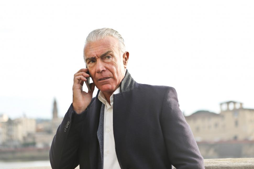 Download Free Stock HD Photo of An old caucasian man calling on his mobile phone during the day Online