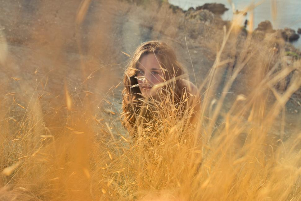 Download Free Stock HD Photo of A young woman posing in the meadow Online